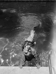 Day 039 (H o l l y.) Tags: lomography 110mm film analog kodak bw black white no color self portrait swimming girl bathing suit summer fun home tattoo blonde movement motion retro indie vintage water pool lazy friday again i laid out caught up reading then more art projects