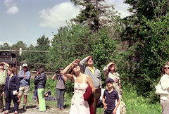 71-060 (ndpa / s. lundeen, archivist) Tags: nick dewolf nickdewolf color photographbynickdewolf 1975 1970s film 35mm 71 reel71 hanggliding hangglidingfestival spectators onlookers observers shieldingtheireyes men women children kids child boy building lodge sky bluesky clouds trees glasses sunglasses shades denim jeans man woman people hat cap blond blonde binoculars franconia franconianotch newhampshire newengland mittersillalpineresort mittersill cannonmountain whitemountains worldcup competition hangglidingcompetition summer worldcupmeet meet mittersillworldcupmeet july