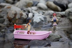Stuck without oar (curtis.mchale) Tags: woman girl lady water boat pink oars oar legoboat lego
