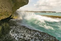 AR44 (jennypowisphotography) Tags: wave rocks slowspeed blues browns foam sea