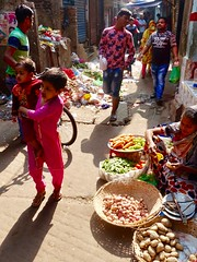 An alley with people selling a few vegetables. (gerrypopplestone) Tags: alleys passageways genevacamp