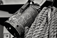 Oil can & rope. (Steve.T.) Tags: blackandwhite bnw textured texture textures mono 50mm nikon d7200 oilcan scratch scratches battered weathered rope retro vintage
