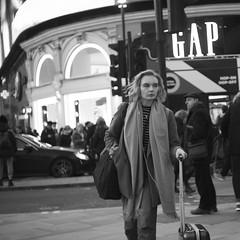 Piccadilly (Darryl Scot-Walker) Tags: londonstreets londonstreetphotography piccadillycircus canon dslr street monochrome woman commuters pedestrians citylife blackandwhite eos5dsr zeissjena zeiss