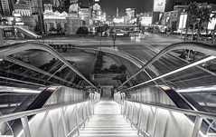 A city that never sleeps (PeterThoeny) Tags: lasvegas lasvegasstrip nevada usa stairs night cityscape escalator street boulevard intersection outdoor symmetry perspective onepointperspective longexposure sony a6000 selp1650 2xp raw hdr qualityhdr qualityhdrphotography photomatix fav200