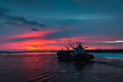Always moving (langdon10) Tags: canada quebec stlawrenceriver sunset troisrivieres water containership ice ship shoreline snow winter