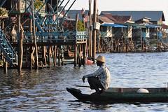 Sundown on the Tonle Sap. (nabilkannan) Tags: tonlesap tonlesaplake siemreap cambodia travelphotography travelshots travel water lake floatingvillage sundown boat boatman