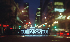 TAXI CAB (Jovan Jimenez) Tags: canon t50 fd 50mm f14 fujiflim pro 400h night sign taxi cab chicago film bokeh analog analogue cinematic streetphotography vintagelens manuallens manualfocus oldlens grain plustek opticfilm 8200i ai fujicolor city lights lowcon manual lens adapted adaptedlens adaptedlenses