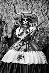 Viva La Vida (belleshaw) Tags: blackandwhite dayofthedead riversideca skull portrait lacalaveracatrina costume facepaint sombrero rifle gun dress mexicanflag bandolier bullets tree texture celebration tradition girl