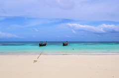 Two lonely boats in the Andaman Sea (B℮n) Tags: kolipe kohlipe เกาะหลีเป๊ะ kohlippy adangrawi archipelago ploysiam speedboat national park kohturatao koturatao kohlipeh nationalparkkohtarutao tarutao bounty island thailand anadamansea sandy beach pakbara marinepark snorkling adang rawi tourism vacation holiday coral reef tropical nemo chaolay boat palmtree coconuts crystal clear water seawater siam longtail province satun blue thai sunrise deserted sunbathing lowseason rainyseason relax paradise swimming salisaresort pinetree pijnboom kohusen palm tree rope working man unloading carry weight men carrying heavy boats two happyplanet 100faves topf100