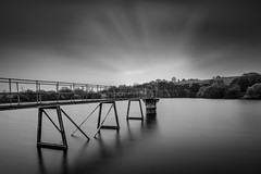 The bridge between (Niaic) Tags: blackandwhite monochrome longexposure nd filter water glassy cloud cloudy clouds movement blur reservoir bridge pier jetty tower contrast structure landscape zeiss loxia2821 sony a7ii