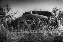Studebaker in the Grass (A Anderson Photography, over 2.9 million views) Tags: abandoned studebaker rust canon bw mono chrome
