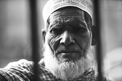 The Beggar Kalam (N A Y E E M) Tags: kalam oldman beggar portrait friday afternoon naturallight fence street pitstop restaurant laalkhanbazaar chittagong bangladesh