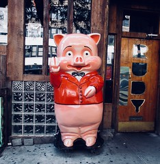 2019 Happy Year of the Wild Boar 6117A (Brechtbug) Tags: rudy waving pig repainted outside rudys bar 9th avenue 44th street new york city 2014 nyc statue sculpture standee cartoon character type pink red creature retouched modified polychrome porky mascot happy bars paint job wheels 2019 year wild boar