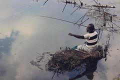 IMG_0534 (M Azharul Islam) Tags: canoneos70d 50mmf18 canon 50prime westbangal fisherman winter travelphotography travel dinajpur street bangladesh oldman portrait fishing fishinglife river reflection