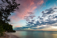 Michigan Summer Sunset Palette (matthewkaz) Tags: christmascove christmascovebeach sunset sky clouds lakemichigan lake water greatlakes reflection reflections puremichigan leelanau leelanaupeninsula summer beach trees longexposure northport michigan 2017