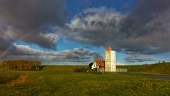 Over The Rainbow (Alfred Grupstra) Tags: lighthouse tower sky famousplace cloudsky history architecture landscape nature outdoors scenics church grass blue summer builtstructure buildingexterior sea coastline europe rainbow