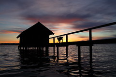 boathouse pier check by sergeant eddie (bkellerstrass) Tags: sonnenuntergang sunset see lake ammersee bavaria stegen bayern hund dog silhouette gegenlicht bootshaus pier steg holz hut hütte wolken clouds wasser wellen water