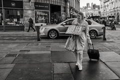your god in my womb (Daz Smith) Tags: dazsmith fujifilmxt3 xt3 fuji bath city streetphotography people candid portrait citylife thecity urban streets uk monochrome blancoynegro blackandwhite mono god womb sign woman