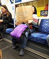 Burden (Peter Denton) Tags: londonunderground greenpark publictransport shoppingbag burden primark ©peterdenton woman candid train carriage carrierbag