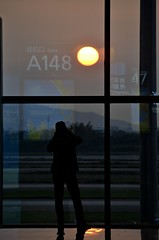Gate A148 (Pedestrian Photographer) Tags: china red sunrise silhouette man window reversed