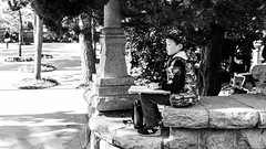 Looking for inspiration (Go-tea 郭天) Tags: qingdao shandong chine cn badaguan painting paint drawing draw class kid child boy young artist art inspiration paper cap alone lonely focus free sun sunny shadow rocks sit seat seated seating garden portrait street urban city outside outdoor people candid bw bnw black white blackwhite blackandwhite monochrome naturallight natural light asia asian china chinese canon eos 100d 24mm prime