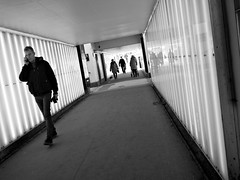 Light Tunnel (saxild) Tags: olympus pen pl5 mzuiko 17mm 17mm18 digital bw black white light tunnel strreet streetphotography streetphoto walking man lyngby station