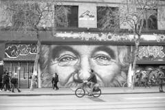 . (m_travels) Tags: people bike marketst sf street man kodaktrix400 film analogue homedevelopedfilm blackandwhite cinestilldf96 mural candid