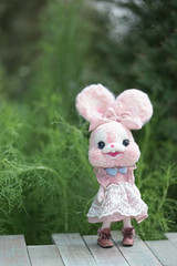 Cute rabbit doll. A soft focus of a cute pink bunny doll with abstract blurred background of plants and trees looks like forest. Toy photography is increasingly popular nowadays. (enchanted.fairy) Tags: animal baby background beautiful best birthday bunny cartoon classic clothing cotton creative creativity cute decoration design doll fairytale felt friendship fun funny gift handmade hare hobby homemade kids macro photo photographer photography photoshoot pink postcard present rabbit retro small souvenir stuffed style surprise teddy textile toy travelling wooden wool yarn
