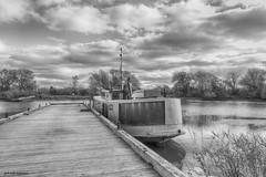 At The Dock (gabi-h) Tags: monochrome blackandwhite boat dock gabih pointtraverse princeedwardcounty water sky trees clouds