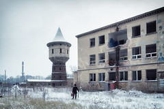 Sentenced to Teardown (Ralph Graef) Tags: urbex abandoned traveller decay desolation disused tower dystopia drabness cold cool winter snow dreary melancholia staged figure facade