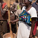 Togo - among the Konkomba - a woman laughs when she sees a man attempting to demonstrate how to use a pestle and mortar