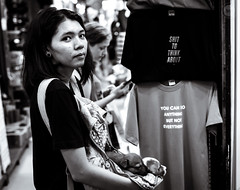What do you want? (dlerps) Tags: bkk bangkok city daniellerps lerps sony sonyalpha sonyalpha99ii tha thai thailand urban lerpsphotography metropolitan dog animal market woman girl streetphotography weekendmarket chatuchakmarket asian asia shirt tshirt monochrome bw blackwhite looking carlzeiss carlzeissplanar50mmf14ssm planart1450 clothes puppies puppy happyplanet asiafavorites