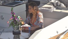 Coffee and Cookies on board.... (markwilkins64) Tags: boat coffee cookies sunshine shade greece lady stylish morninglight markwilkins mark breakfast flowers candid portrait portraiture candidportrait street streetphotography solitude daydreaming