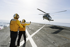 On the top deck of the USS San Diego, U.S. Navy personnel monitor a helicopter landing. Original from NASA. Digitally enhanced by rawpixel. (Free Public Domain Illustrations by rawpixel) Tags: aircraft aircraftcarrier army chopper crew cruiser helicopter landing logistic logistics military name ocean orionunderwayrecoverytest pdnasa personnel publicdomain sea soldier topdeck transport transportation usnavy usssandiego war warship
