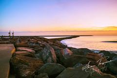 Pier (apayne931) Tags: pier ocean beach sea setting sun sunset sunshine sunrays sunsetting wales horizon evening rocks water sky clear clearsky clouds dusk