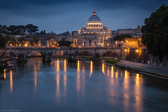 Dusk on St Peter's (Through_Urizen) Tags: category citiestowns italy landscape places rivertiber rome stpetersbasilica sunset vatican city cityscape buildings evening dusk lightsatnight river watercourse reflections reflectedlight cathedral bridge arches architecture travelphotography canon1585mm canon550d canon outdoor longexposure lightstars houses thevatican