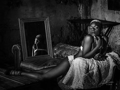 The stretched cat (Saurí) Tags: stretched cat blackandwhite black power africangirl model woman art photograpy josepmsaurí