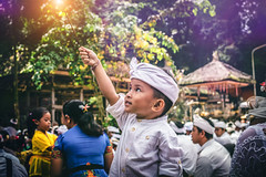BALI, INDONESIA - JULY 4, 2018: Balinese boy with magic stick on a traditional ceremony. (Artem Bali) Tags: balinese asia child indonesia asian bali indonesian traditional culture people young boy kid smile travel happy outdoor editorial person portrait cute face beautiful childhood lifestyle little fun girl happiness looking silenceday procession park destination poverty school offering family southeast cheerful tradition holiday ethnic style temple decoration religious island children knowledge