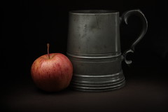 Pewter tankard and apple (Chriscarma) Tags: tankard apple lowkey stilllife darkbackground food drink pewter old lighting soft macromondays