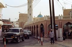 Oman 2 (Lennart Arendes) Tags: canon ae1 film analog 35mm kodak 200 gold mutrah oman maskat city cars traffic street architecture mosque shops