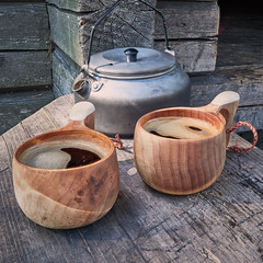 Two wooden mugs filled with coffee (Digikuvaaja) Tags: wooden coffeemug outdoor drink hot coffeepot coffee mug breakfast adventure hiking fall camp vacation lifestyle warm cooking extreme survival outside metal beverage rest leisure campsite hike morning camping wanderlust activity rustic caffeine journey steam