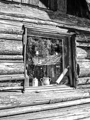 History's Reflection (by Deborah K Photography) Tags: canada dustyroadphotos canons5 blackandwhite sepia minimumcolour cabin vintage windows britishcolumbia ruralways ruralliving ruralphotography monochrome logcabin scenic deborahkphotography dustyroadpics antique canadian stilllife simpleliving bw