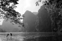 Ninh Binh - Impressive rocks in Dry Halong Bay (www.holgersbilderwelt.de) Tags: ninhbinh vietnam rocks nature beautiful white light sky water black travel landscape tree clouds lake river mountain reflection plant wild outdoor monochrome botany flora shadow amazing weather scenic lovely tranquility countryside perspective waterscape rustic schwarzweiss valley aperture
