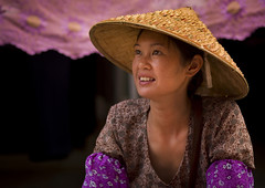 Young Woman With A Chinese Hat, Menglun, Yunnan Province, China (Eric Lafforgue) Tags: a0006996 adultsonly asia china chineseethnicity colorpicture hat horizontal onepeople oneperson onewomanonly orientalethnicity portrait realpeople sideview smile strawhat traditionallychinese waistup womenonly xishuangbanna youngadult yunnan yunnanprovince menglun