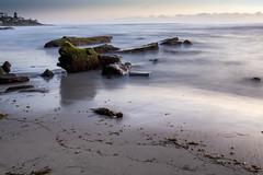Rocks on the Beach at Low Tide (Photos By Clark) Tags: california cities subjects beachshots location canon2470 unitedstates northamerica sandiego canon5div locale places where us longexposure 15seconds fifteenseconds pacific rocks sand waves water ocean moss sunset afterdark thesandiegoist