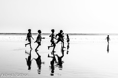Run (asheshr) Tags: bnw beach beachphotography blackwhite blackandwhite d7200 hikey highkey kids kidsplaying mono monochrome nikkon nikkond7200 nikkor nikkor18140mm
