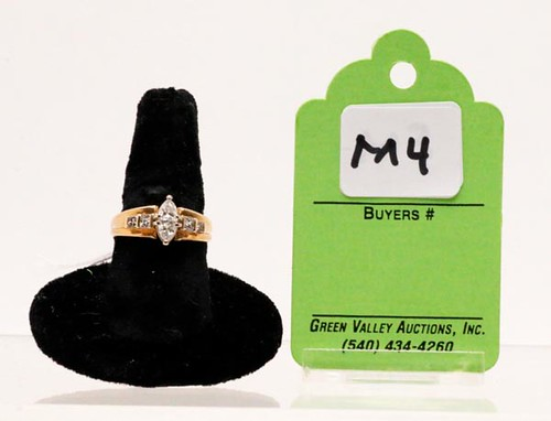 14k yellow gold lady's ring w/ 4 princess & 2 pear shaped diamonds, size 9.5, approximately 1.20 ct. ($700.00)