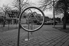 A wander with Ken - March 2019-8 (Philip Gillespie) Tags: canon 5dsr edinburgh old new town girl fishnets green hair sunset orange mono monochrome blackandwhite blackwhite circle bike bicycles buildings architecture close towers street cars traffic parliament building warm royal mile water wet pond pool sky clouds black white photography local