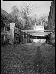 photographer's shadow, urban landscape, architectural remnants, River District, Ashevile, North Carolina, Mamiya 645 Pro, mamiya sekor 45mm f-2.8, Bergger Pancro 400, Ilford Ilfosol 3 developer, 1.5.19 (steve aimone) Tags: photographersshadow urbanlandscape architecturalforms architecturalremnants riverdistrict asheville northcarolina mamiya645pro mamiyasekkor45mmf28 mamiyaprime primelens 120 120film film mediumformat monochrome monochromatic blackandwhite
