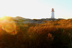 annihilation (Julianne Baker) Tags: sunset lighthouse peggys cove nova scotia canada fall grass rocks ocean beautiful landscape yellow clear skies sky blue red light house shine shimmer sun bright annhilation movie inspiration chats road trip